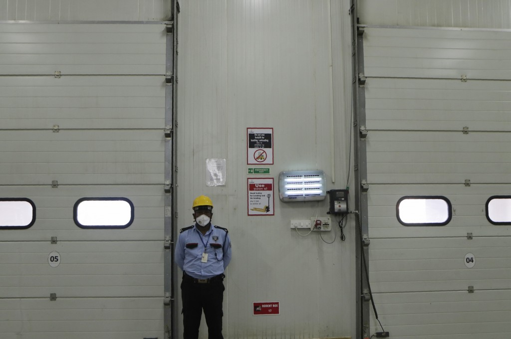 A security guard stands by at Snowman Logistics, India's largest cold storage company in Taloja on the outskirts of Mumbai, India, Saturday, Oct. 17, ...