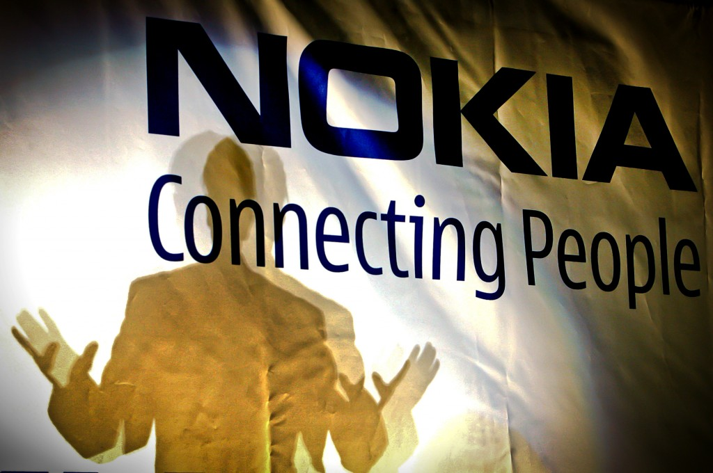 FILE -- In this Feb. 11, 2008 file picture, general manager of the Nokia factory in Romania, John Guerry, casts a shadow on a banner at the new Nokia ...