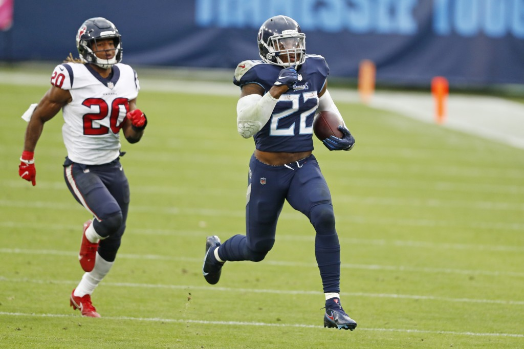 Tennessee Titans running back Derrick Henry (22) beats Houston Texans strong safety Justin Reid (20) as Henry runs 94 yards for a touchdown in the sec...