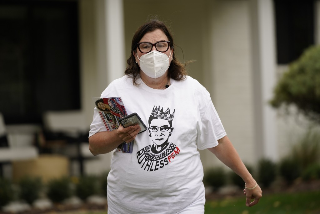 Lori Goldman canvasses in Troy, Mich., Thursday, Oct. 15, 2020. For most of her life, until 2016, Goldman had been politically apathetic. Had you offe...