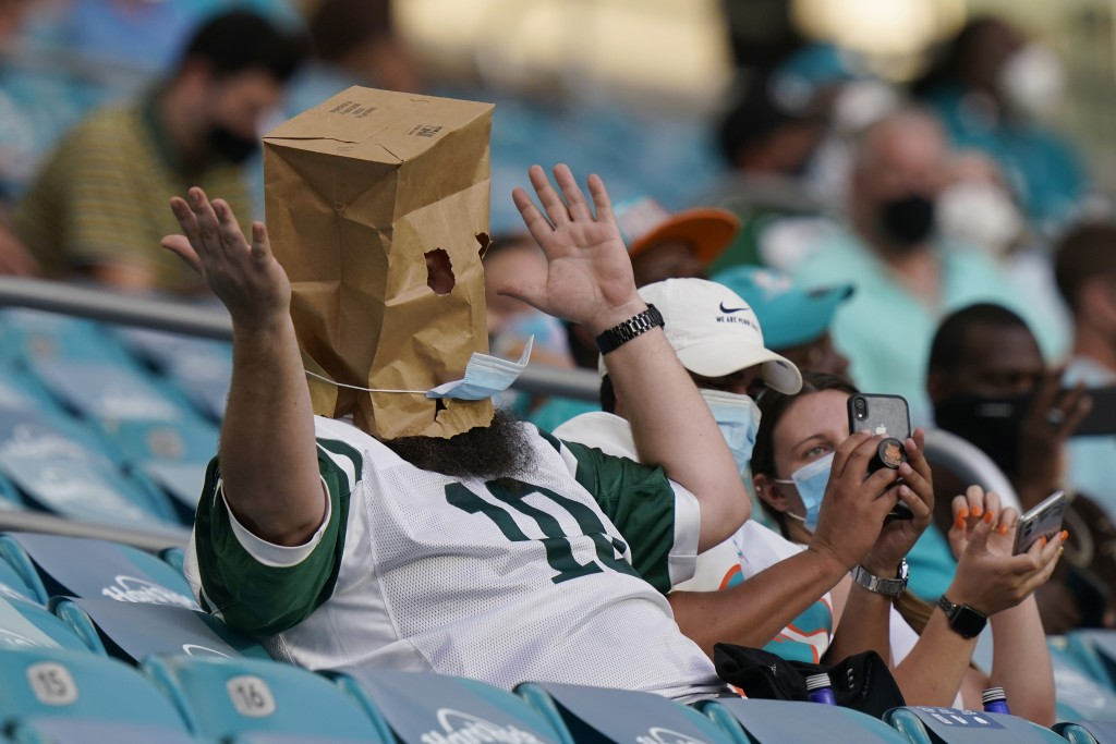 A New York Jets fans reacts to the team performance during the second half of an NFL football game against the Miami Dolphins, Sunday, Oct. 18, 2020, ...