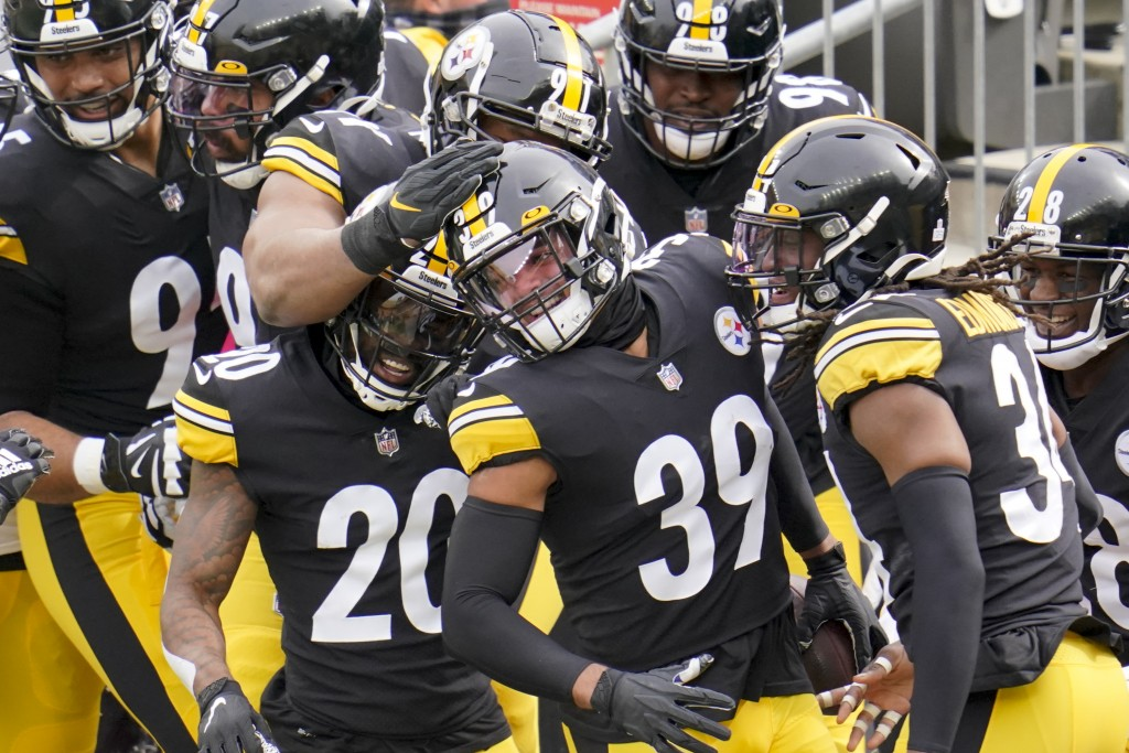 Pittsburgh Steelers free safety Minkah Fitzpatrick (39) is greeted by teammates in the end zone after intercepting a pass buy Cleveland Browns quarter...