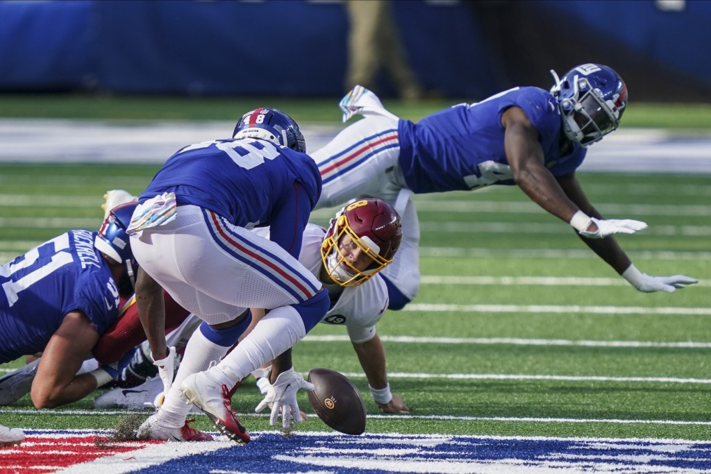 Washington Football Team quarterback Kyle Allen (8) loses control of the ball and watches New York Giants linebacker Tae Crowder (48) recover it durin...