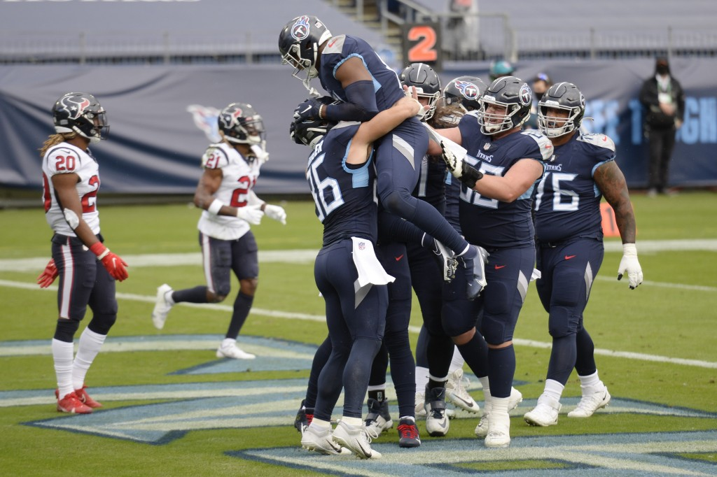 Tennessee Titans tight end Anthony Firkser (86) celebrates with teammates after catching a touchdown pass against the Houston Texans in the first half...