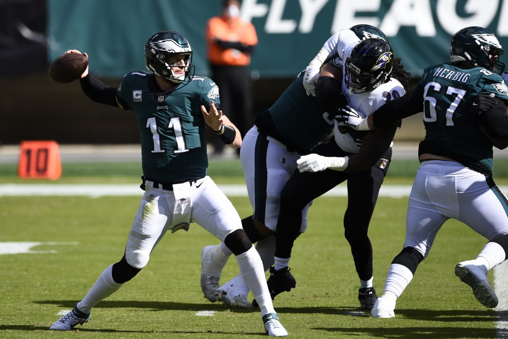 Philadelphia Eagles' Carson Wentz passes during the first half of an NFL football game against the Baltimore Ravens, Sunday, Oct. 18, 2020, in Philade...