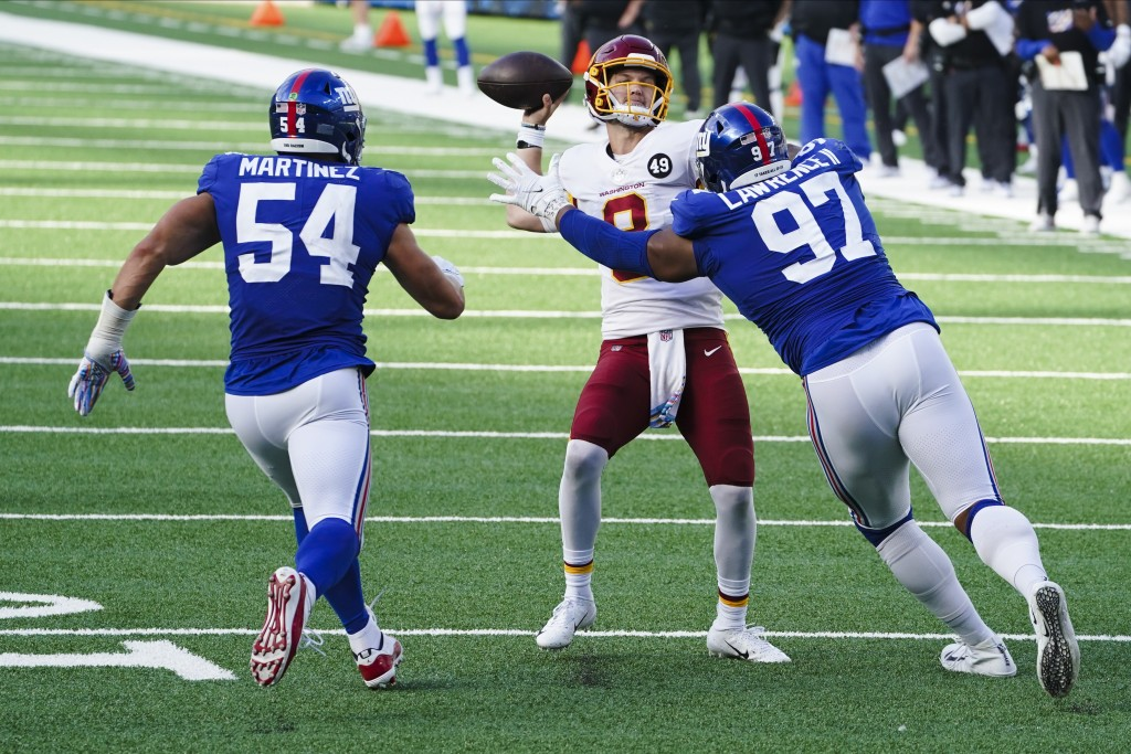 New York Giants defensive tackle Dexter Lawrence (97) and Blake Martinez (54) rush Washington Football Team quarterback Kyle Allen (8) during a point ...