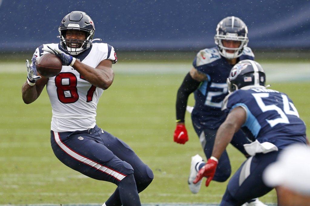 Houston Texans tight end Darren Fells (87) catches a pass as Tennessee Titans inside linebacker Rashaan Evans (54) closes in during the first half of ...
