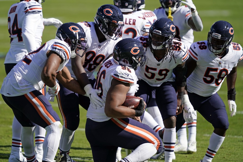 Chicago Bears defensive end Akiem Hicks (96) is congratulated by teammates following a turnover during the second half of an NFL football game against...