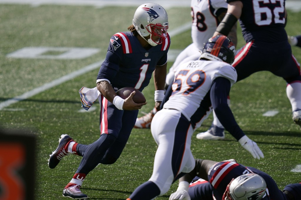 New England Patriots quarterback Cam Newton (1) runs for yardage against the Denver Broncos in the first half of an NFL football game, Sunday, Oct. 18...