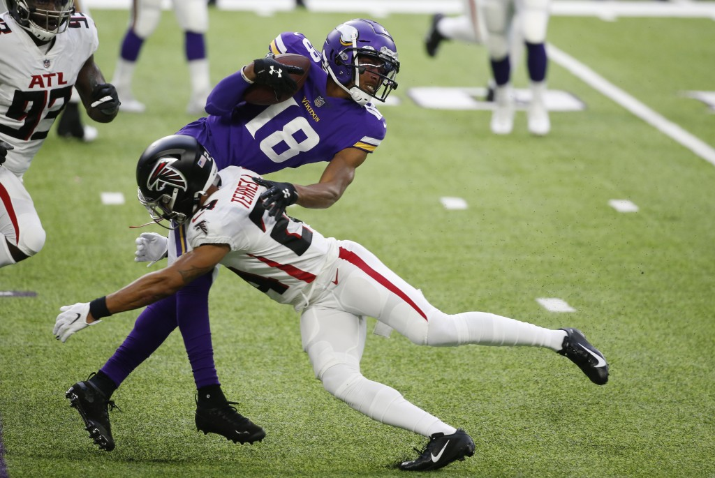 Minnesota Vikings wide receiver Justin Jefferson (18) is tackled by Atlanta Falcons cornerback A.J. Terrell during the first half of an NFL football g...