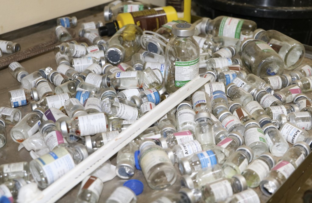 Empty vaccine bottles lie on a tray inside a small clinic in Gampela village on the outskirts of Burkina Faso's capital, Ouagadougou, Saturday Oct. 10...