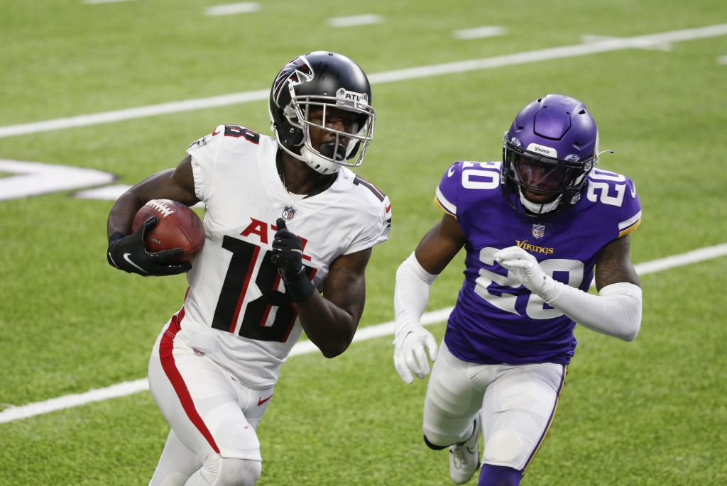 Atlanta Falcons wide receiver Calvin Ridley (18) runs from Minnesota Vikings cornerback Jeff Gladney (20) during an 8-yard touchdown reception during ...
