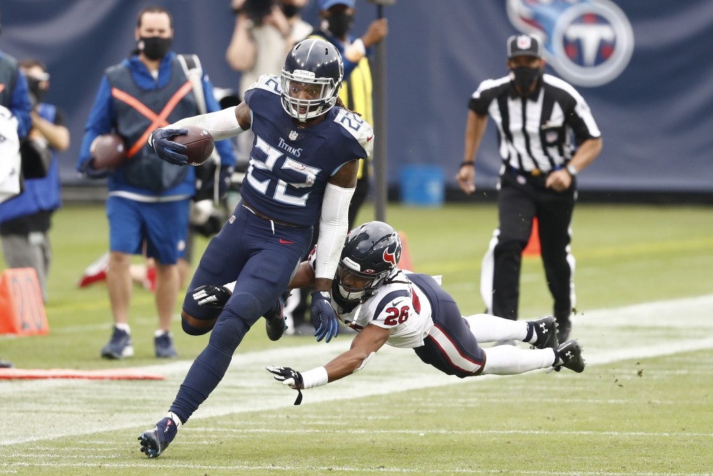 Tennessee Titans running back Derrick Henry (22) gets past Houston Texans cornerback Vernon Hargreaves III (26) as Henry runs for 53 yards in overtime...