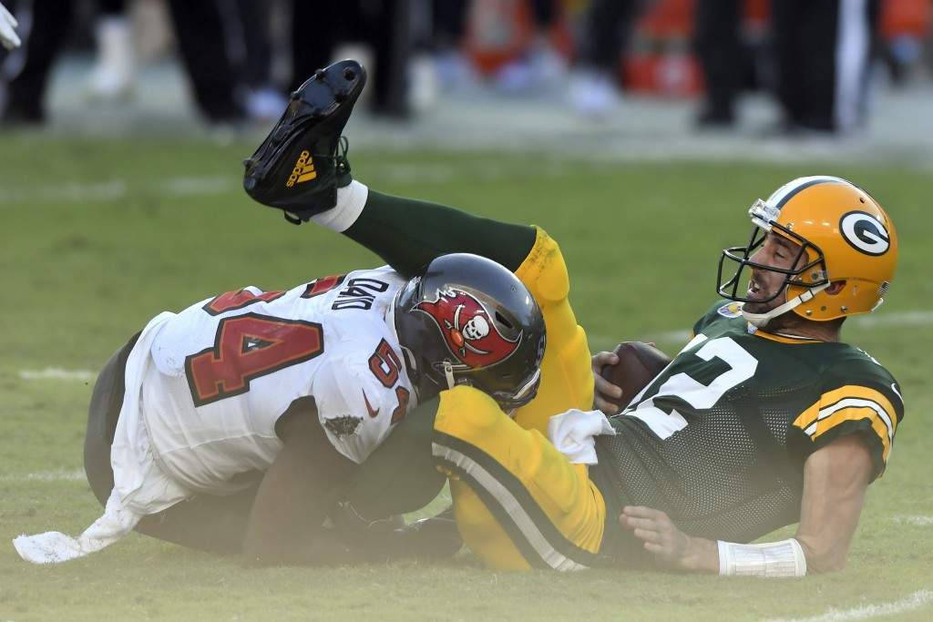 Green Bay Packers quarterback Aaron Rodgers (12) gets sacked by Tampa Bay Buccaneers inside linebacker Lavonte David (54) during the first half of an ...