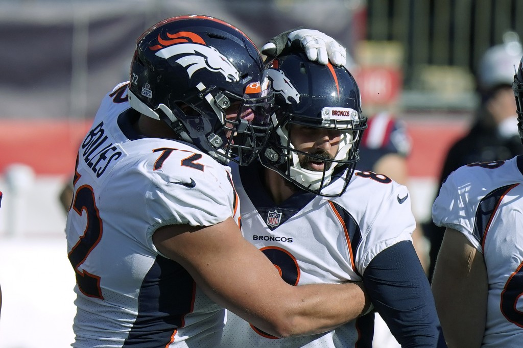 Denver Broncos offensive tackle Garett Bolles, left, congratulates kicker Brandon McManus in the second half of an NFL football game after his sixth f...
