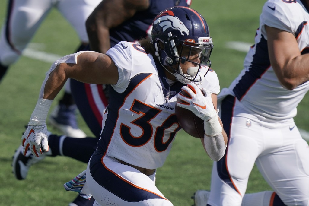 Denver Broncos running back Phillip Lindsay carries the ball in the first half of an NFL football game against the New England Patriots, Sunday, Oct. ...