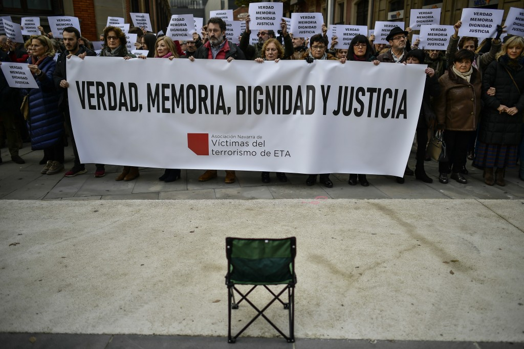 """FILE - In this Dec. 28, 2018 file photo, relatives of people killed by the dissolved Basque armed group ETA, hold banners that read: """"True, Memory, Di..."""