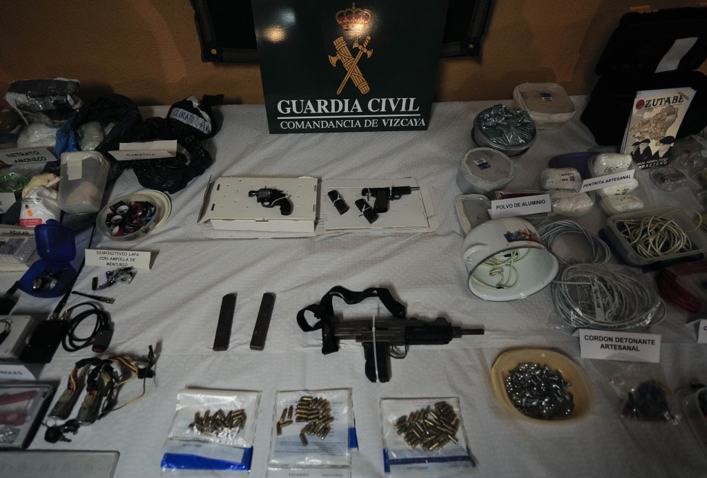 FILE - In this March 1, 2011 file photo, a display of munitions, weapons and 200 kilograms of explosives captured from the Basque separatist group ETA...