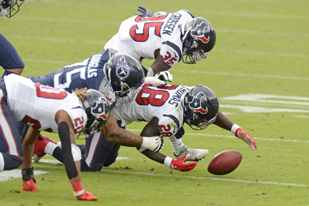 Houston Texans' Michael Thomas (28) recovers a blocked field goal attempt by the Tennessee Titans in the second half of an NFL football game Sunday, O...