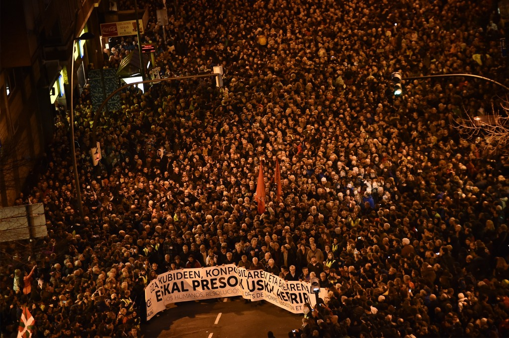 """FILE - In this Jan 9, 2016 file photo, demonstrators hold a banner that reads in Basque language, """"All rights for the Basque prisoners"""", as pro-indepe..."""