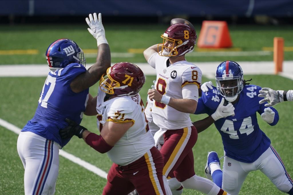 Washington Football Team offensive guard Wes Schweitzer (71) blocks New York Giants' Dexter Lawrence (97) as quarterback Kyle Allen (8) throws a pass ...
