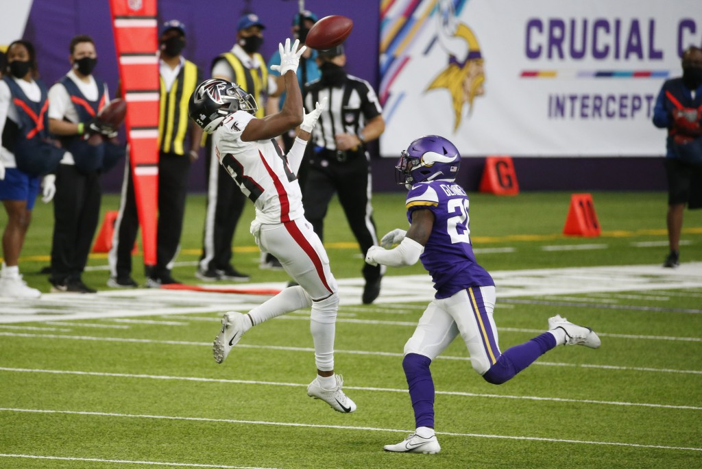 Atlanta Falcons wide receiver Russell Gage, left, catches a pass over Minnesota Vikings cornerback Jeff Gladney, right, during the second half of an N...