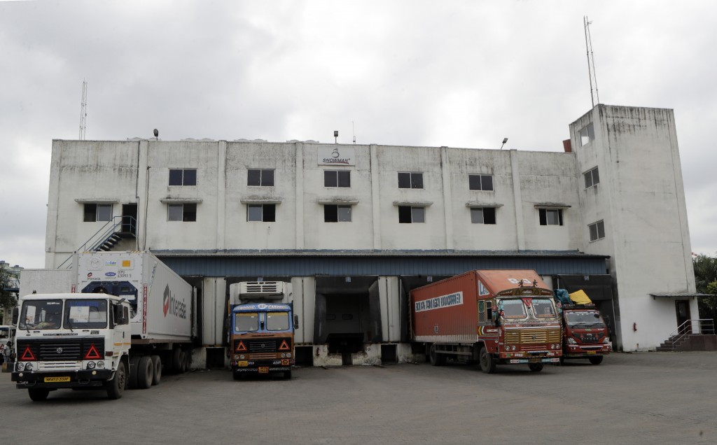 Trucks parked outside Snowman Logistics, India's largest cold storage company in Taloja, outskirts of Mumbai, India, Saturday, Oct. 17, 2020. The vacc...