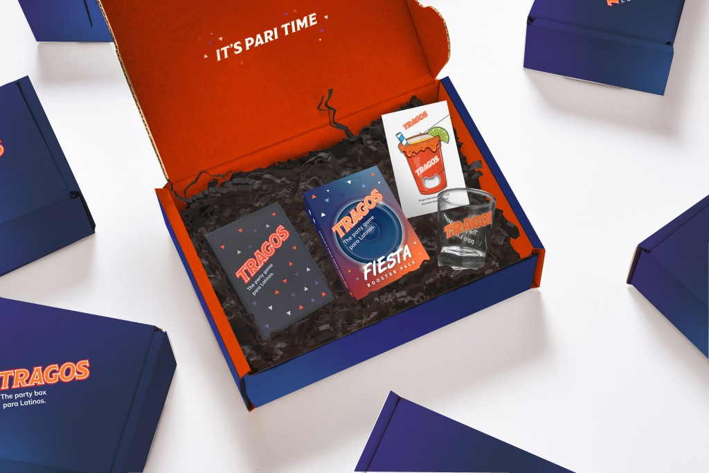This image shows a party game focused on Latino pop culture. the Tragos Stay Home Pack and includes such activities as showing off your best moves to ...