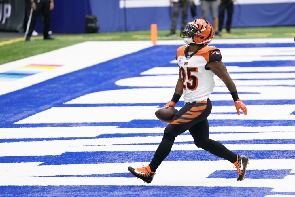 Cincinnati Bengals' Giovani Bernard celebrates after running for a touchdown during the first half of an NFL football game against the Indianapolis Co...