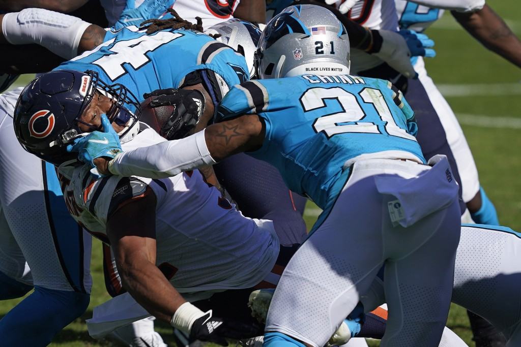 Chicago Bears running back David Montgomery runs the ball while Carolina Panthers outside linebacker Jeremy Chinn (21) moves in to tackle during the s...