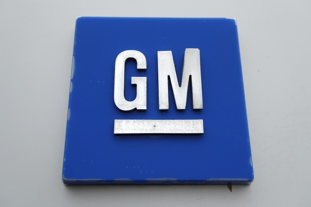 This Monday, Jan. 27, 2020, photo shows the General Motors logo. General Motors is expected to reveal that it will build the Cadillac Lyriq electric S...
