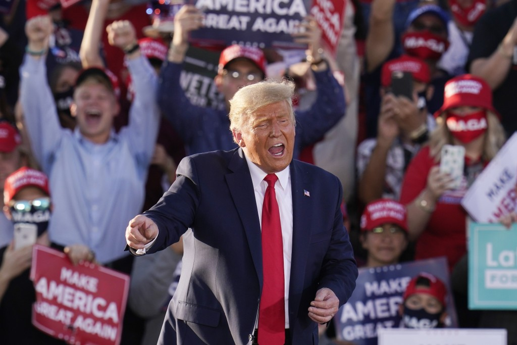 President Donald Trump works the crowd after speaking at a campaign rally Monday, Oct. 19, 2020, in Tucson, Ariz. (AP Photo/Ross D. Franklin)