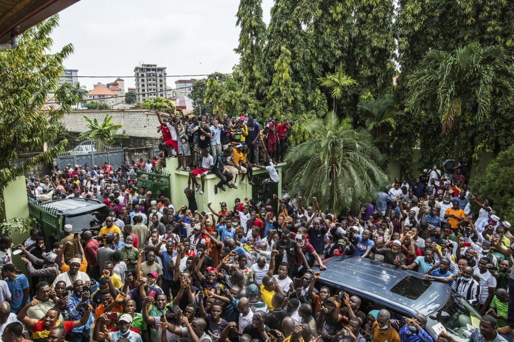 Supporters of Guinean opposition leader Cellou Dalein Diallo cheer at his headquarters in Conakry, Guinea, Monday Oct. 19, 2020. Diallo declared himse...
