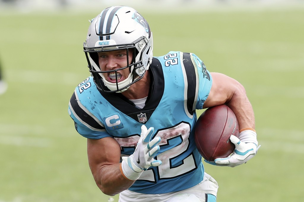 Carolina Panthers running back Christian McCaffrey (22) rushes for a touchdown against the Tampa Bay Buccaneers during the second half of an NFL footb...