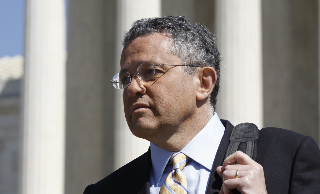 FILE - CNN legal analyst Jeffrey Toobin leaves the Supreme Court after it finished the day's arguments on the health care law signed by President Bara...