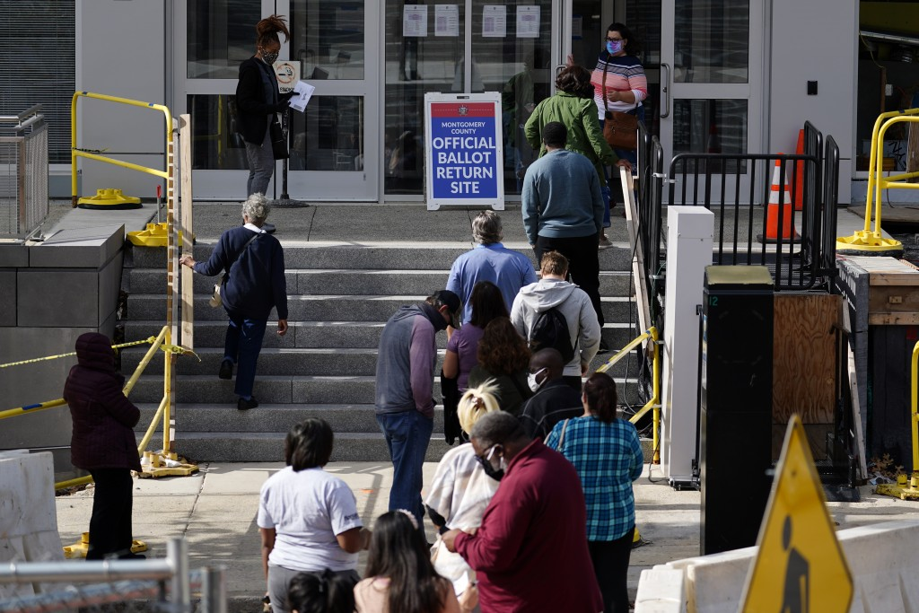 Residents line up outside the Montgomery County, Pa., Voter Services office, Monday, Oct. 19, 2020, in Norristown, Pa. Monday is the last day in Penns...