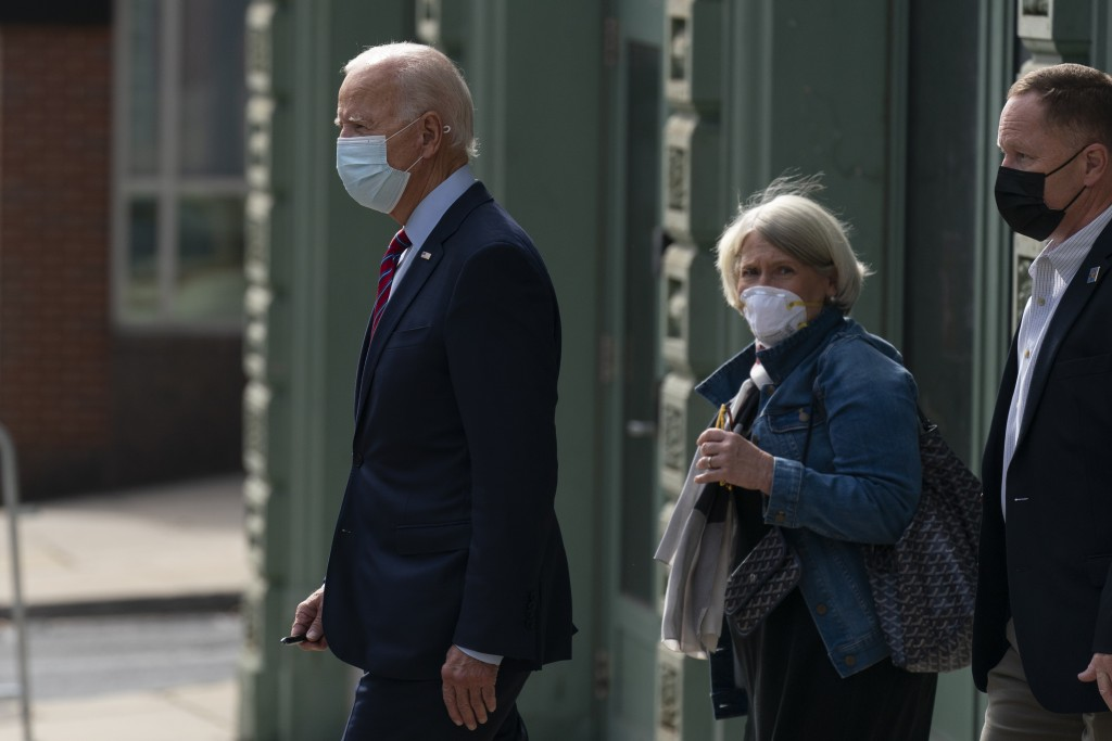 Democratic presidential candidate former Vice President Joe Biden and Anita Dunn center, depart The Queen theatre in Wilmington, Del., Monday, Oct. 19...