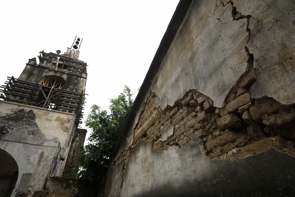 An earthquake cracked wall is seen beside a damaged turret, at the former San Guillermo Convent, where restoration work is underway three years after ...