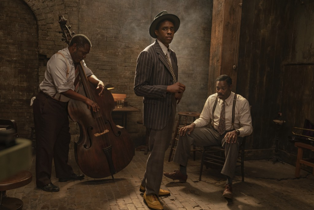 """This image released by Netflix shows Michael Potts, from left, Chadwick Boseman and Colman Domingo in """"Ma Rainey's Black Bottom."""" Netflix on Monday pr..."""