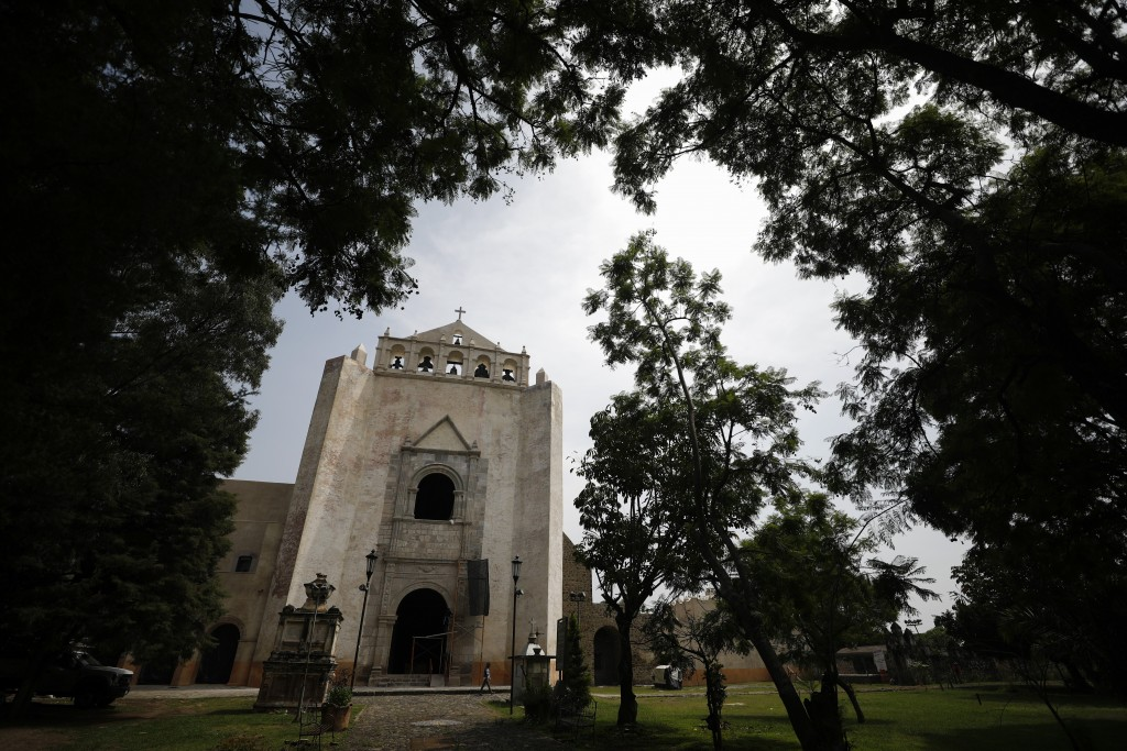 The reconstructed bell gable and repaired church facade stand at the former San Juan Bautista Convent, where restoration work is underway following da...