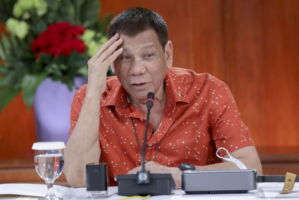 In this photo provided by the Malacanang Presidential Photographers Division, Philippine President Rodrigo Duterte attends a meeting at the Malacanang...
