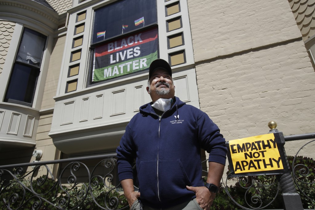 FILE - In this June 14, 2020, file photo, James Juanillo poses outside of his home in San Francisco. Fed up with white people calling 911 about people...