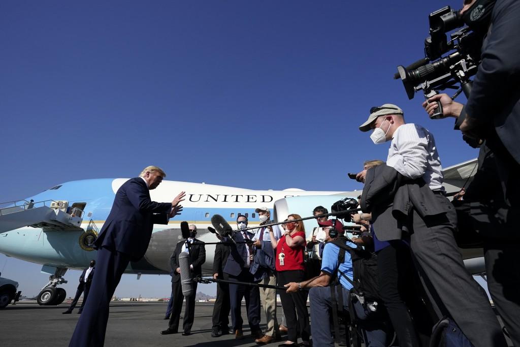 President Donald Trump speaks to reporters at Phoenix Sky Harbor International Airport, Monday, Oct. 19, 2020, in Phoenix. (AP Photo/Alex Brandon)