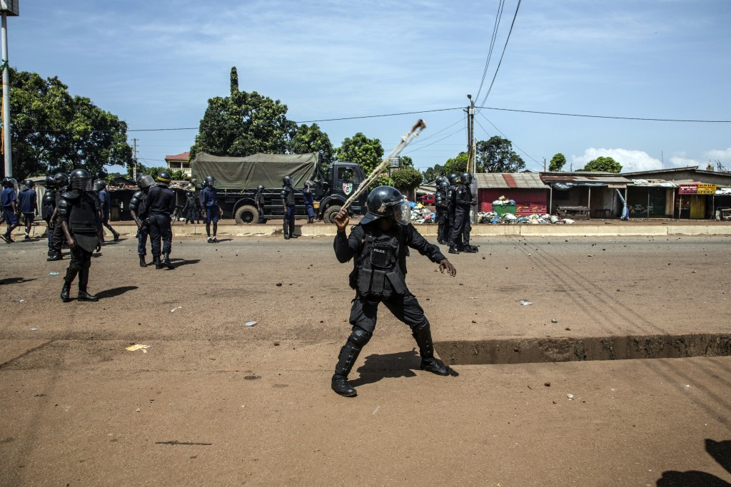 Police engage supporters of Guinean opposition leader Cellou Dalein Diallo demonstrating in Conakry, Guinea, Wednesday, Oct. 21, 2020. Diallo declared...