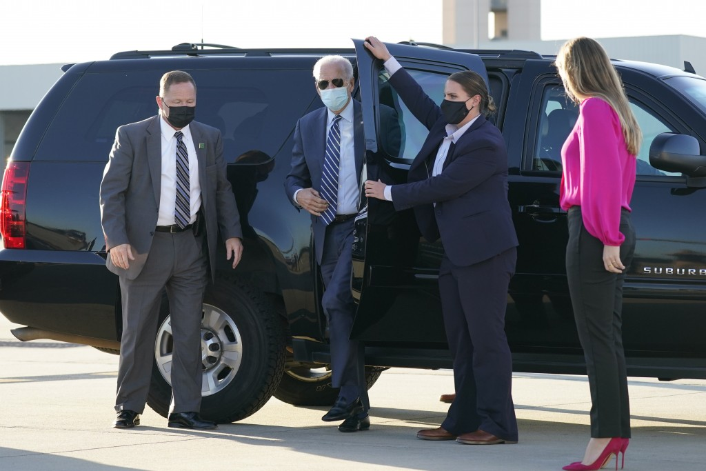 In this Oct. 18, 2020, photo, Democratic presidential candidate former Vice President Joe Biden steps out to board his campaign plane at Raleigh-Durha...