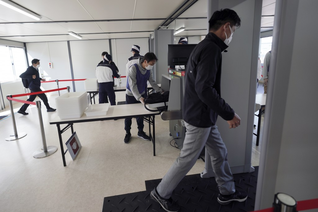 Staffs and security personnel participate in a screening test for spectators and officials to ensure a safe and secure Toyo Olympic Games Wednesday, O...