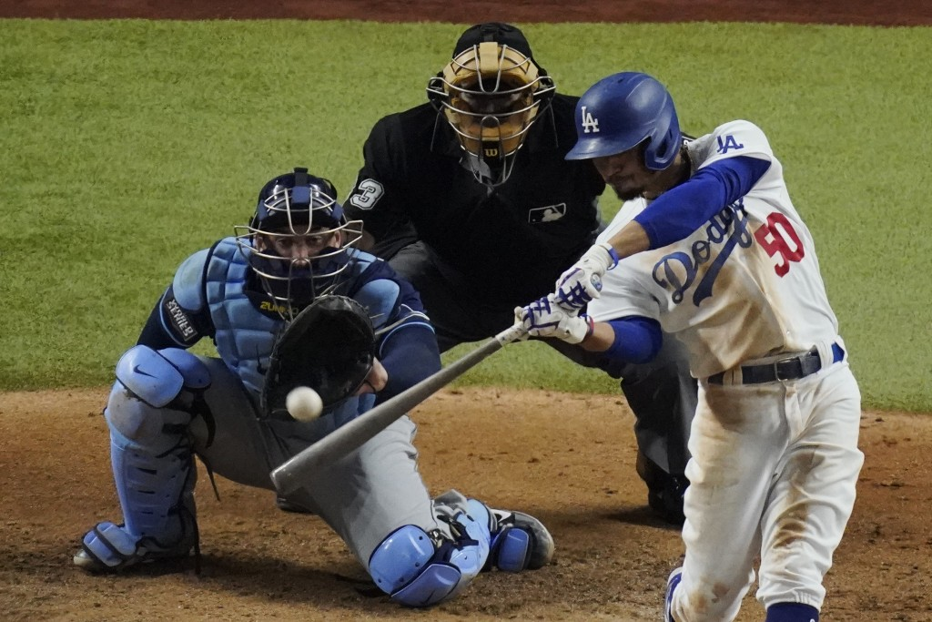 Los Angeles Dodgers' Mookie Betts hits a home run against the Tampa Bay Rays during the sixth inning in Game 1 of the baseball World Series Tuesday, O...
