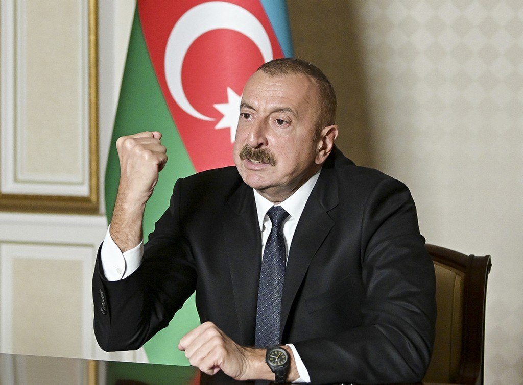 In this photo provided by the Azerbaijan's Presidential Press Office onTuesday, Oct. 20, 2020, Azerbaijani President Ilham Aliyev gestures as he addre...