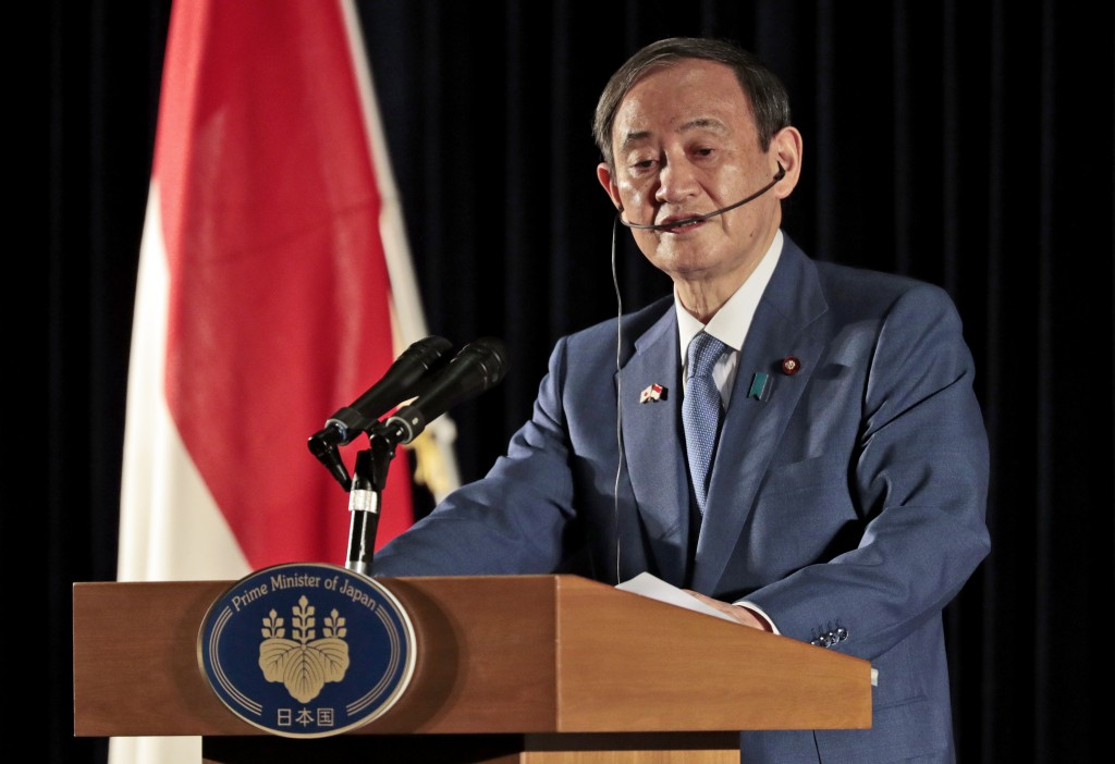Japanese Prime Minister Yoshihide Suga speaks to the media during a press conference in Jakarta, Indonesia, Wednesday, Oct. 21, 2020. Suga is on a fou...