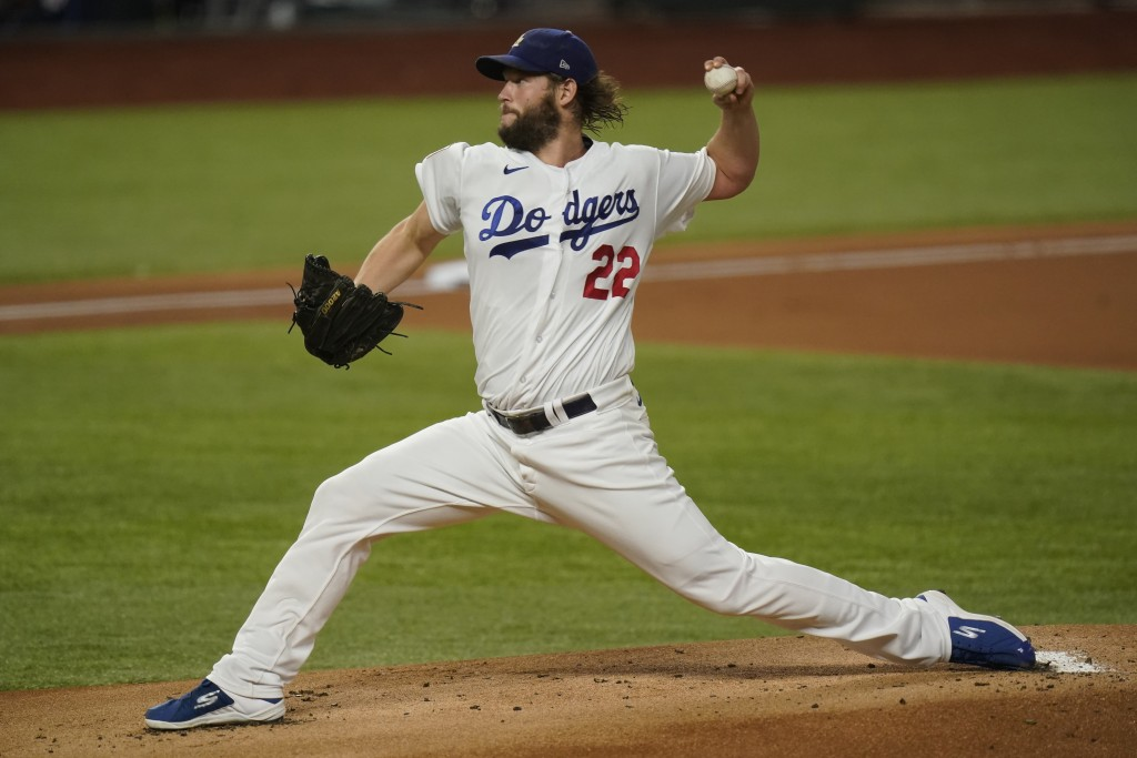 Los Angeles Dodgers starting pitcher Clayton Kershaw throws against the Tampa Bay Rays during the first inning in Game 1 of the baseball World Series ...